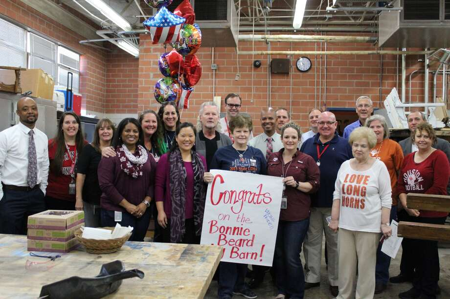 Dulles High School administrators and staff congratulate Ms. Bonnie Beard. Photo: Fort Bend ISD