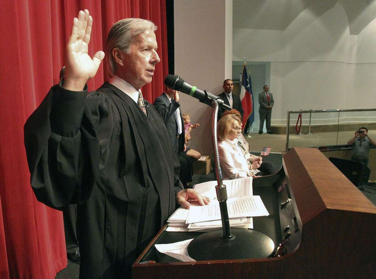 U.S. Magistrate Judge John Primomo had been conducting citizenship ceremonies since 1989. presides over the naturalization ceremony for a group of new citizens at the Edgewood Academy's Theatre of Performing Arts on July 31, 2014.