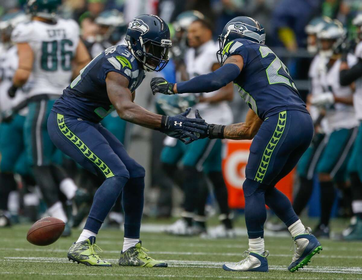 Safety Kam Chancellor of the Seattle Seahawks celebrates with free safety Earl Thomas after intercepting a pass in the second quarter against the Philadelphia Eagles at CenturyLink Field on November 20, 2016 in Seattle, Washington. (Photo by Otto Greule Jr/Getty Images)