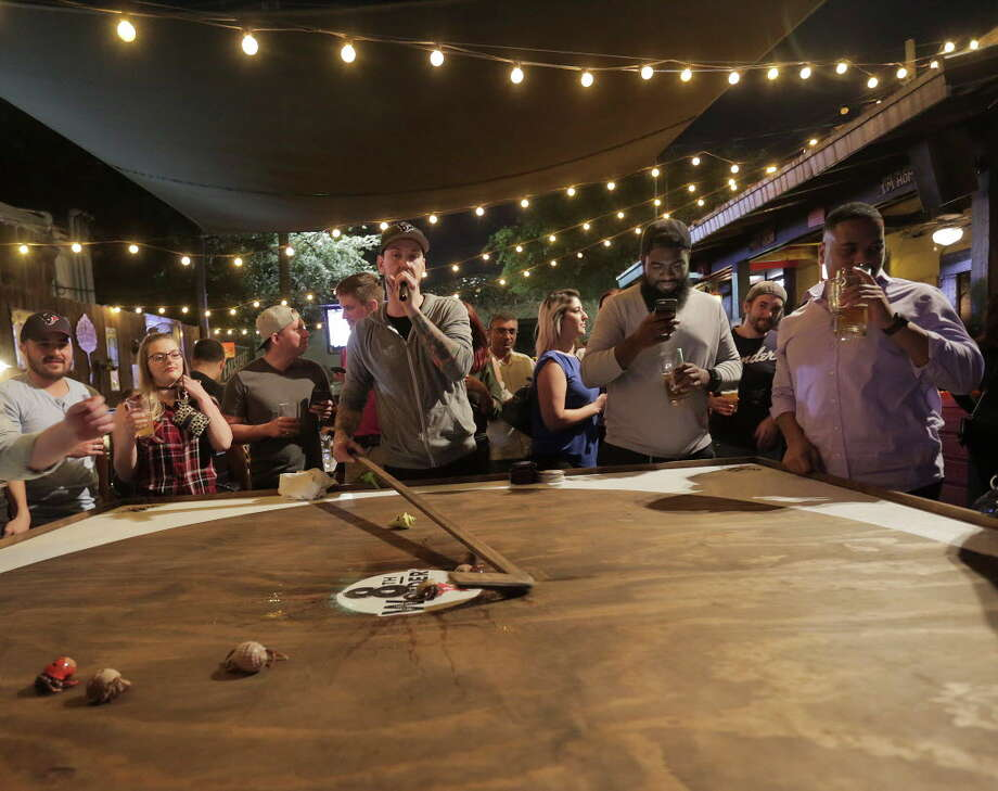 David Kemper gathers the crabs as he emcees the Hermit crab race at Little Woodrows in Eado on Tuesday, Nov. 15, 2016, in Houston. Photo: Elizabeth Conley, Houston Chronicle / © 2016 Houston Chronicle