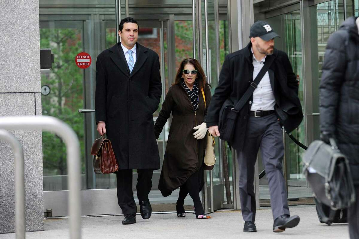 Former Stamford High School Principal Donna Valentine and attorney Ryan O'Neil leave the state Superior Court in Stamford, Conn. on Monday, Nov. 21, 2016. This marks the end of Valentine's accelerated rehab program and her charges will be dismissed.