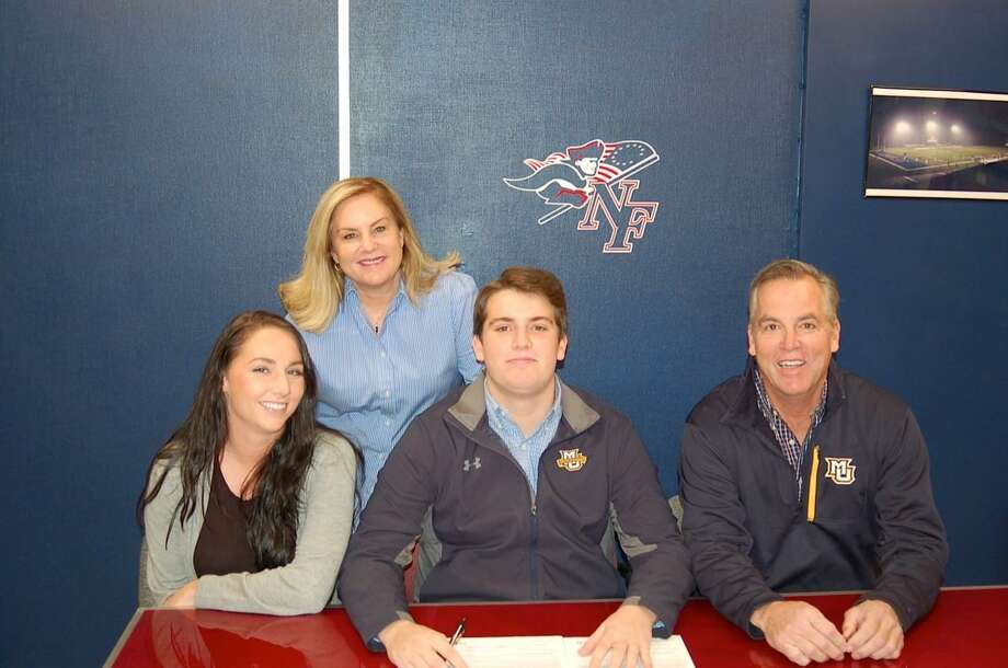 New Fairfield High School senior Gabe Stein, center, signs his National Letter of Intent to play lacrosse at Marquette University. Pictured with him are his sister Sierra, left, mother Susan, back, and father Craig. Photo: Contributed Photo / Contributed Photo