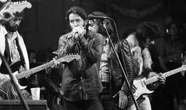 The Last Waltz concert at Winterland November 25, 1976, was filmed by Martin Scorcese In this image, Eric Clapton, Paul Butterfield, Bobby Charles and Ron Wood The Band and many guest musicians performed, including Neil Young, Bob Dylan, Van Morrison Eric Clapton Ron Wood, Ringo Starr, Dr. John  and Joni Mitchell