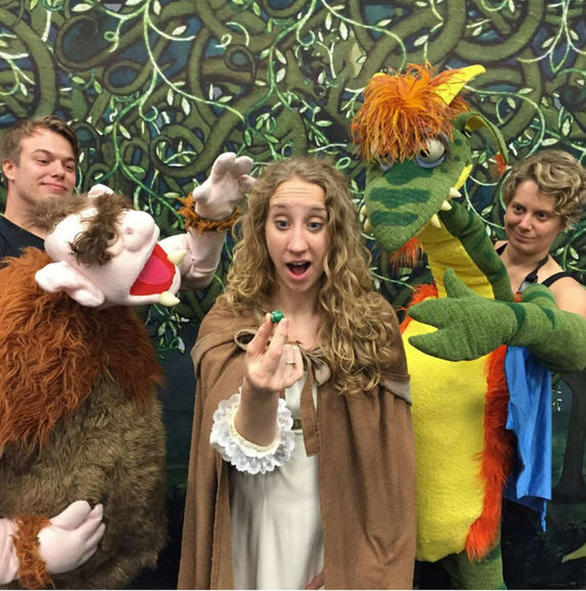 """Eric Delagrange performs as the Ogre, Sydney Anderson as the Princess and Megan Berti as the Dragon in the Houston Grand Opera performance of """"The Princess and The Pea."""""""