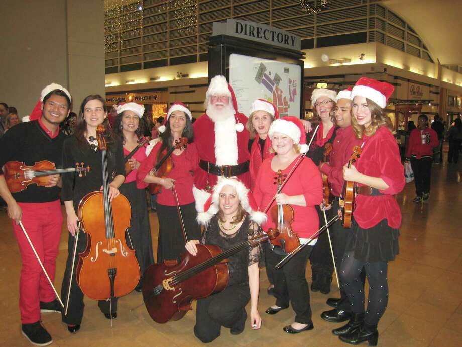 String Theory String Orchestra includes, from left, Sarah Vaughn Porter, Marty Koran, Sharon Hresko, Diana Quam, Anne-Marie Suire, Artemis Ward, Kim Nessler, Sandy Chapman, Sina Thompson and Becky Walker. Photo: Fort Bend County Libraries