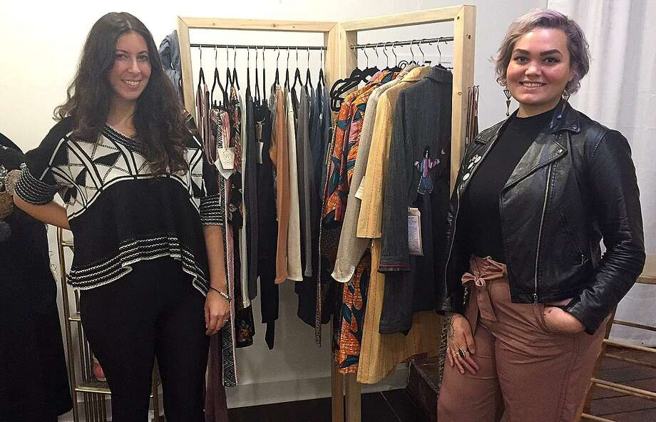 Meagan Cann, left, and Lindsey Ayala stand in the Workspace Collective on Main Street in Danbury, Conn., on Tuesday, Nov. 15, 2016. Cann and Ayala are organizing a holiday bazaar to benefit to the Harambee Center for Youth. Photo: Chris Bosak / Hearst Connecticut Media / The News-Times