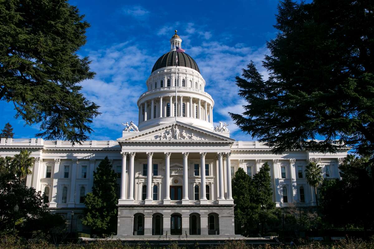 FILE - The dome and exterior of the State Capitol building is viewed on January 27, 2015, in Sacramento, California. The state is expected to lift the stay-at-home order for the Sacramento region on Tuesday, Jan. 12, 2021.