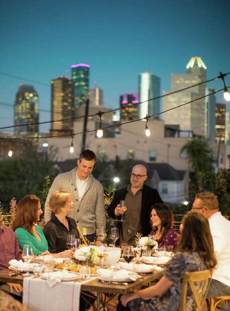 The Pass & Provisions chef-owners Terrence Gallivan, standing left, and Seth Siegel-Gardner, standing right, recently hosted a fall/winter dinner party for their friends on a private rooftop terrace in Houston. Photo: Julie Soefer / Julie Soefer Photography