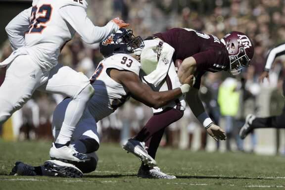 Texas A&M quarterback Jake Hubenak (10) is brought down by UTSA defensive end Marcus Davenport (93) after a short run during the first quarter on Nov. 19, 2016, in College Station.