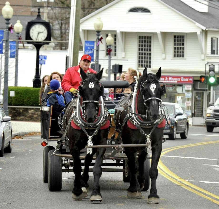Brian Clark drives a horse-drawn carriage on Greenwood Avenue in Bethel as part of the Annual Tree Lighting Festival, Friday, Nov. 26, 2010. Photo: Michael Duffy / ST / The News-Times