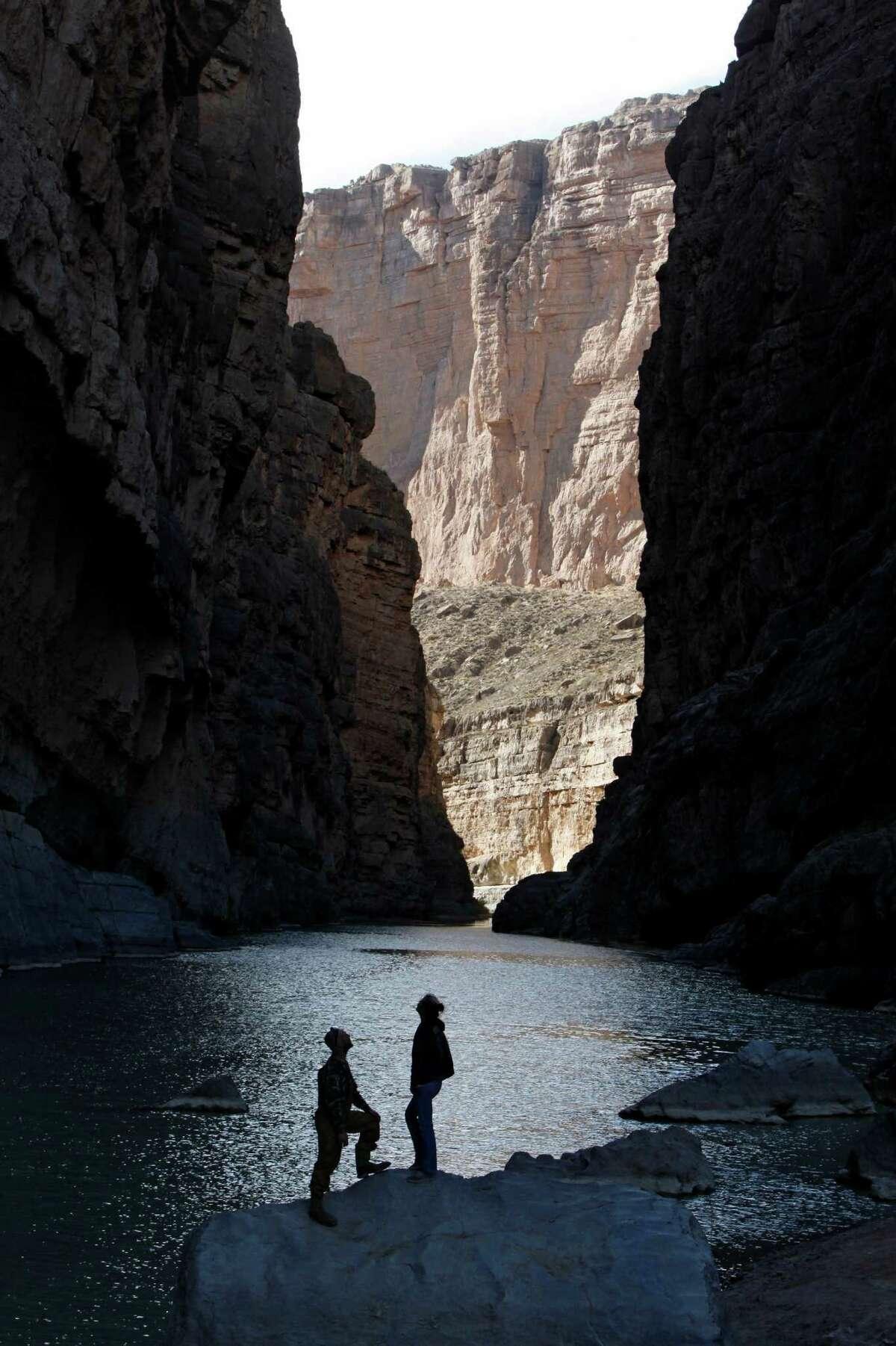 Visitors take in the majesty of the canyon walls at Santa Elena Canyon at Big Bend National Park.