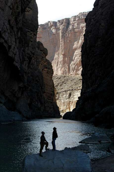 Visitors take in the majesty of the canyon walls at Santa Elena Canyon at Big Bend National Park. Photo: Erich Schlegel, Contributor / 2011 The Washington Post