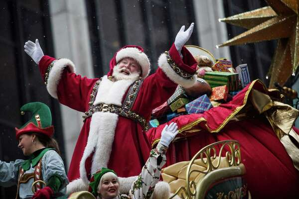 Santa Claus waves to the crowd during the 2014 Macy's Thanksgiving Day Parade in New York City.