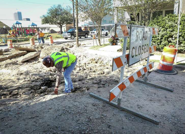 A worker inspects damage caused when a contractor dug into bricks in historic Freedmen's Town, at the corner of Genesee Street and Andrews Street, Monday, Nov. 21, 2016, in Houston. The bricks were laid down by the founders of Freedmen's Town.