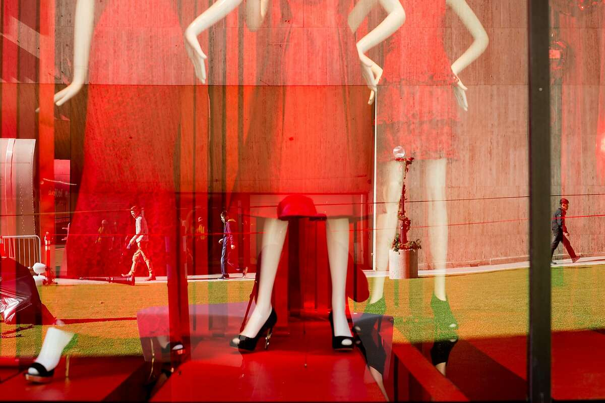 Pedestrians are reflected in a Macy's window display on Stockton St. in San Francisco on Monday, Nov. 21, 2016.