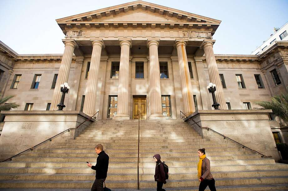The Old Mint's classical Greek revival columns once sheltered a homeless camp. Planners are now seeking a grander vision. Photo: Noah Berger, Special To The Chronicle