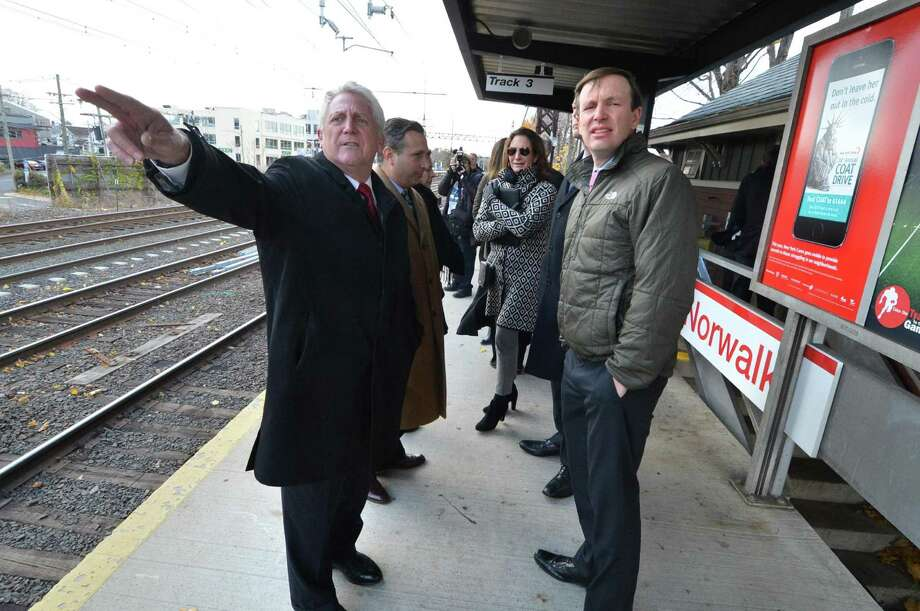 Norwalk Mayor Harry Rilling points in the direction of the eastbound Metro North tracks at the East Norwalk train station  during a tour of the area in need of improvement with US Senator Chris Murphy along with  State Rep Fred Wilms, State Rep Gail Lavielle and State Senator Bob Duff and other city leaders on Monday November 21, 2016 in Norwalk Conn. Photo: Alex Von Kleydorff / Hearst Connecticut Media / Connecticut Post