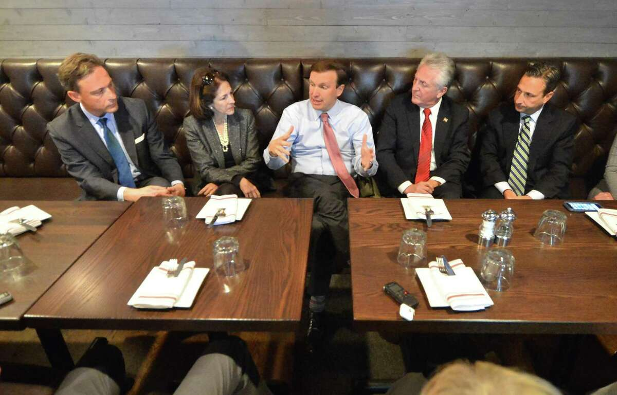 U.S. Senator Chris Murphy makes a point while talking about transportation, roads, rails and the East Norwalk train station during a meeting at The Station House restaurant with State Rep Fred Wilms, State Rep gail Lavielle, Norwalk Mayor Harry Rilling and State Senator Bob Duff and other city leaders on Monday November 21, 2016 in Norwalk Conn.
