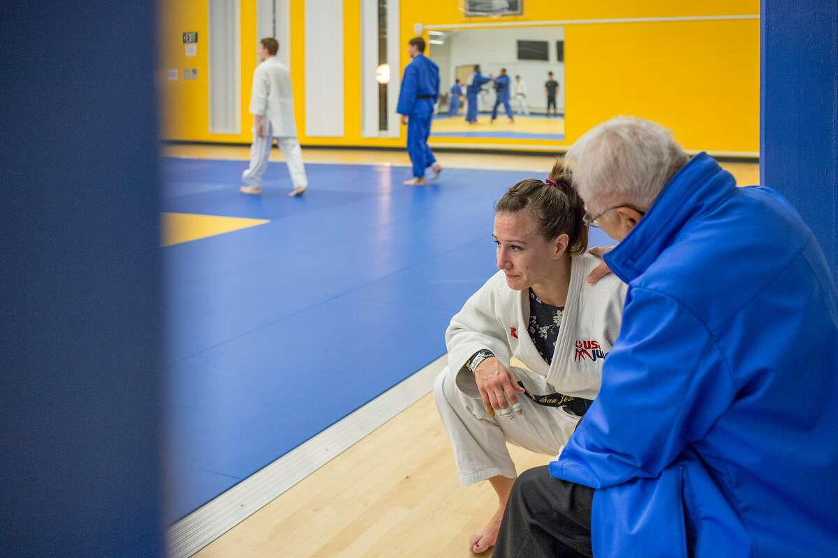 From right: Yoshihiro Uchida embraces Marti Malloy as Malloy talks about struggles in her life, during judo training at San Jose State University�s Yoshihiro Uchida Hall, on Friday, Nov. 18, 2016 in San Jose, Calif. Malloy, a judoka bronze medalist from the 2012 London Olympics, has a challenging time adjusting to life after she was eliminated in the early rounds of the Rio 2016 Olympics. Uchida is Malloy's mentor and the founder of the university's judo program.