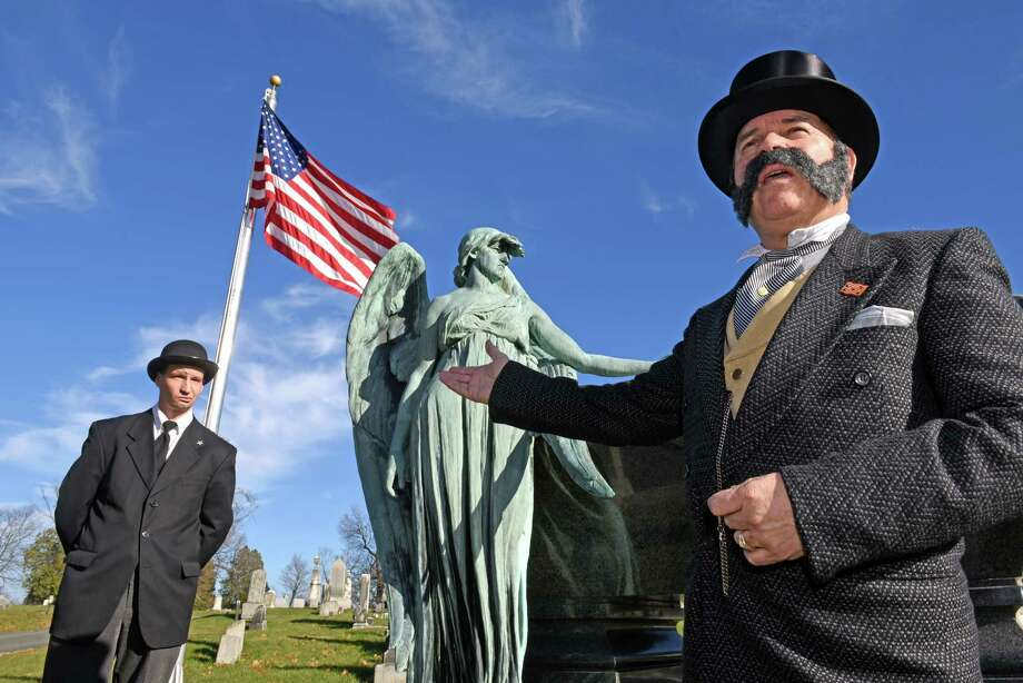Living History actors Kevin Titus portrays 21st US President Chester A. Arthur and Michael Espositoplays his Secret Service Bodyguard at Arthur's grave site on the 130th Anniversary of his death in Albany Rural Cemetery on Friday Nov. 18, 2016 in Menands, N.Y.  (Michael P. Farrell/Times Union) Photo: Michael P. Farrell / 20038876A
