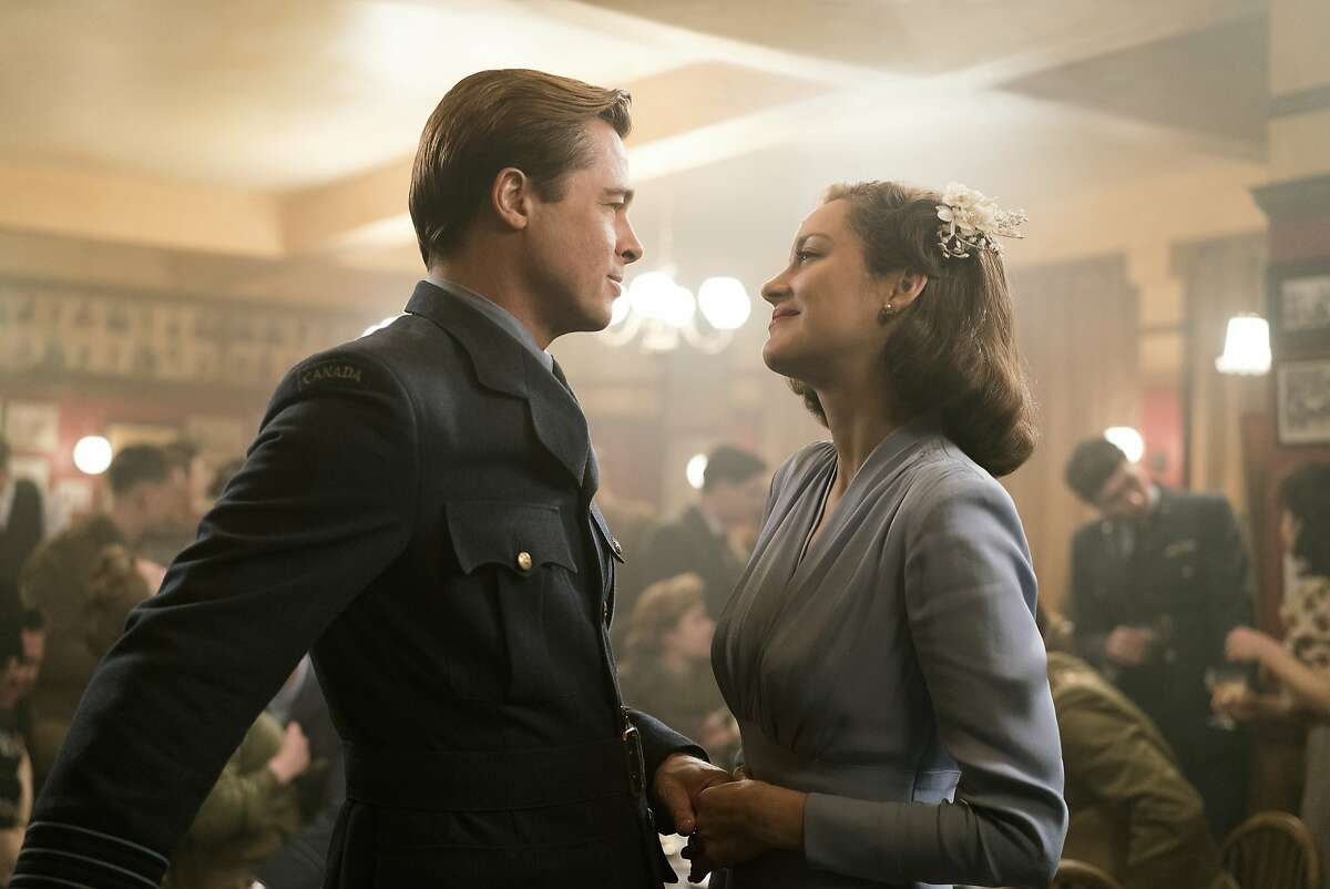 In this image released by Paramount Pictures, Marion Cotillard, right, and Brad Pitt appear in a scene from