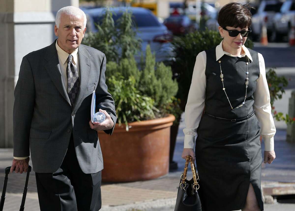 William and Karen Ozer prepare to enter the Hipolito F. Garcia Federal Building and United States Courthouse Monday. The Ozers sued San Antonio attorney Todd Prins in U.S. Bankruptcy Court, accusing him of fabricating court documents and forging judges' signatures. Prins did not appear for the hearing.