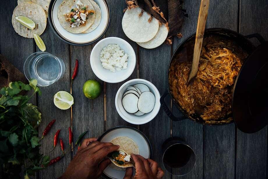 Nik Sharma puts together Turkey Vindaloo Tacos. Photo: Nik Sharma