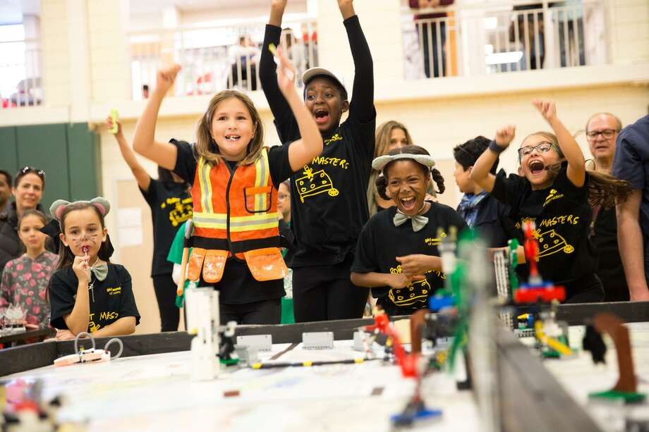 """The Robot Masters"" consisted of Fairfield County Girl Scouts, celebrate a successful round during Greenwich Academy's Backyard Blizzard robotics competition on Saturday November 19, 2016. The Backyard Blizzard is an official Connecticut State First Lego League qualifying event which is a showcase of robotic innovation, hard work, and team spirit, with participating teams coming from all over the state. Photo: Chris Palermo / For Hearst Connecticut Media / Greenwich Time Freelance"