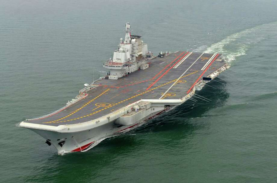 FILE - In this May 2012 file photo provided by China's Xinhua News Agency, Chinese aircraft carrier Liaoning cruises for a test in the sea. China's first aircraft carrier is now ready to engage in combat, marking a milestone for a navy that has invested heavily in its ability to project power far from China's shores. (AP Photo/Xinhua, Li Tang, File) Photo: Li Tang, SUB / AP2012