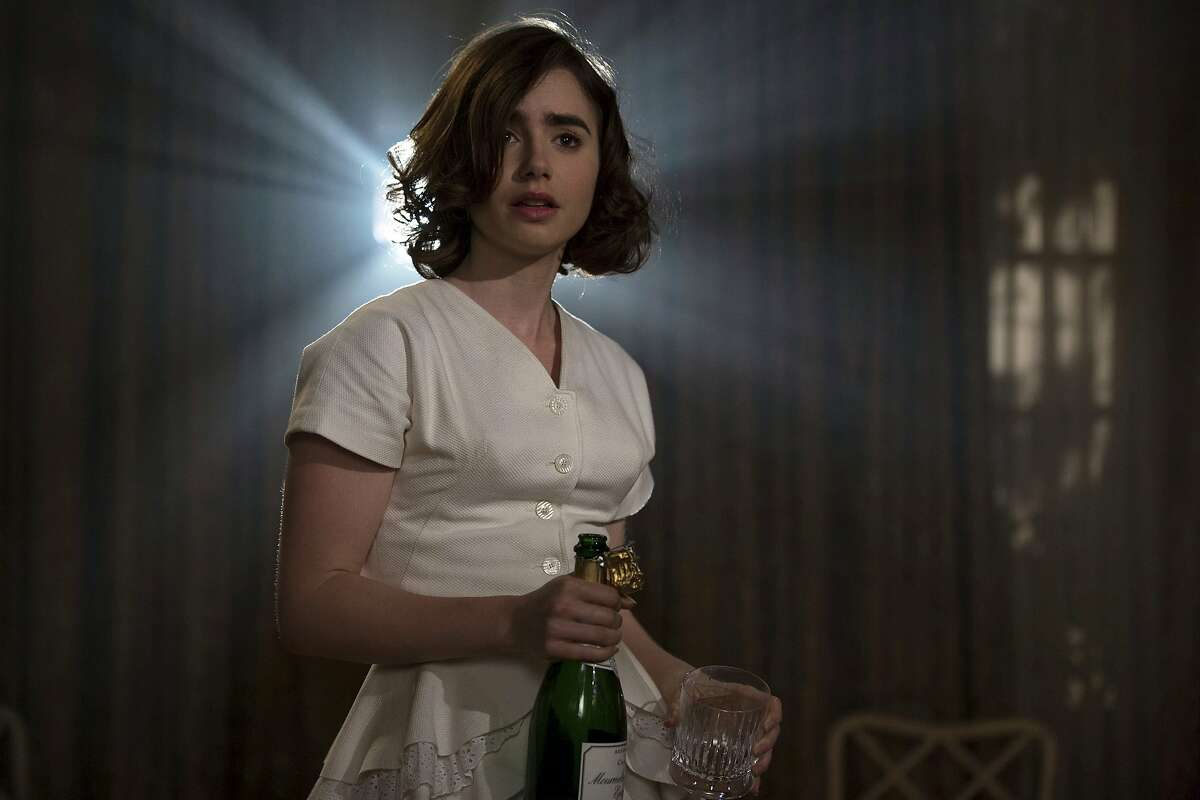 """This image released by Twentieth Century Fox shows Lily Collins in a scene from """"Rules Don't Apply."""" (Francois Duhamel/Twentieth Century Fox via AP)"""