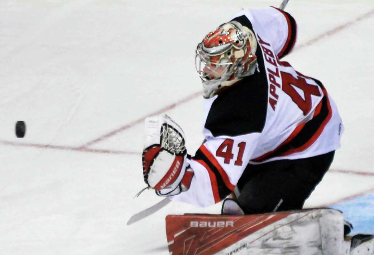 Albany Devils goalie Ken Appleby stops a shot on goal during Saturday's game against the Rochester Americans at the Times Union Center Feb. 13, 2016 in Albany, NY. (John Carl D'Annibale / Times Union) ORG XMIT: MER2016021320020546