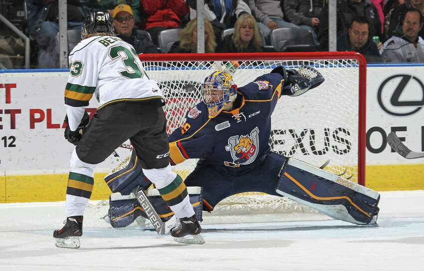 LONDON, ON - OCTOBER 10: Mackenzie Blackwood #29 of the Barrie Colts makes a big save on Julius Bergman #33 of the London Knights in an OHL game at the Budweiser Gardens on October 10, 2014 in London, Ontario, Canada. The Colts defeated the Knights 4-3. (Photo by Claus Andersen/Getty Images) ORG XMIT: 513268489 ORG XMIT: MER2016112115005397