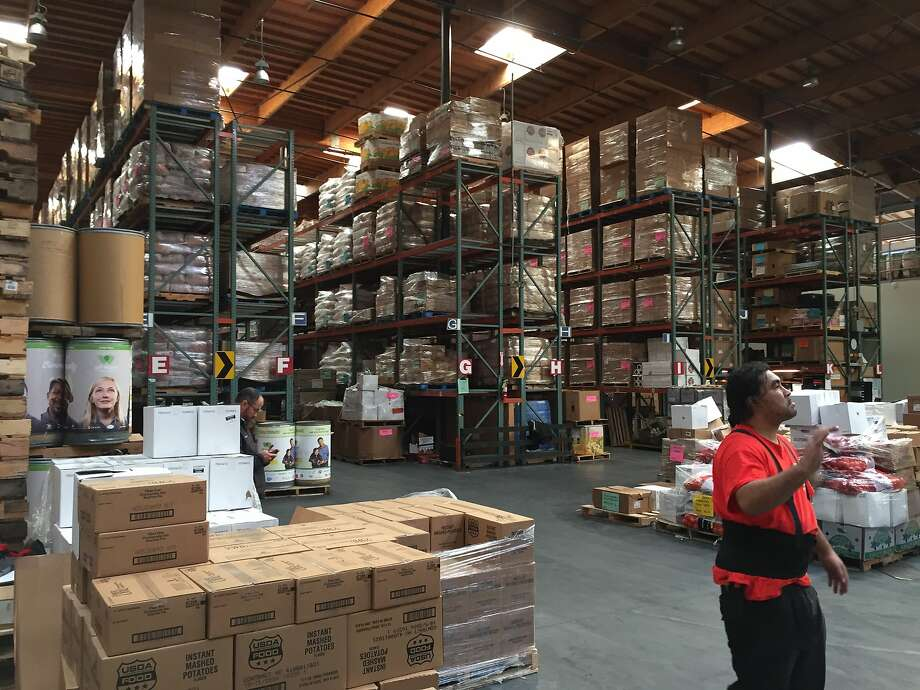 Shelves stacked high at the food bank warehouse. Photo: Beth Spotswood