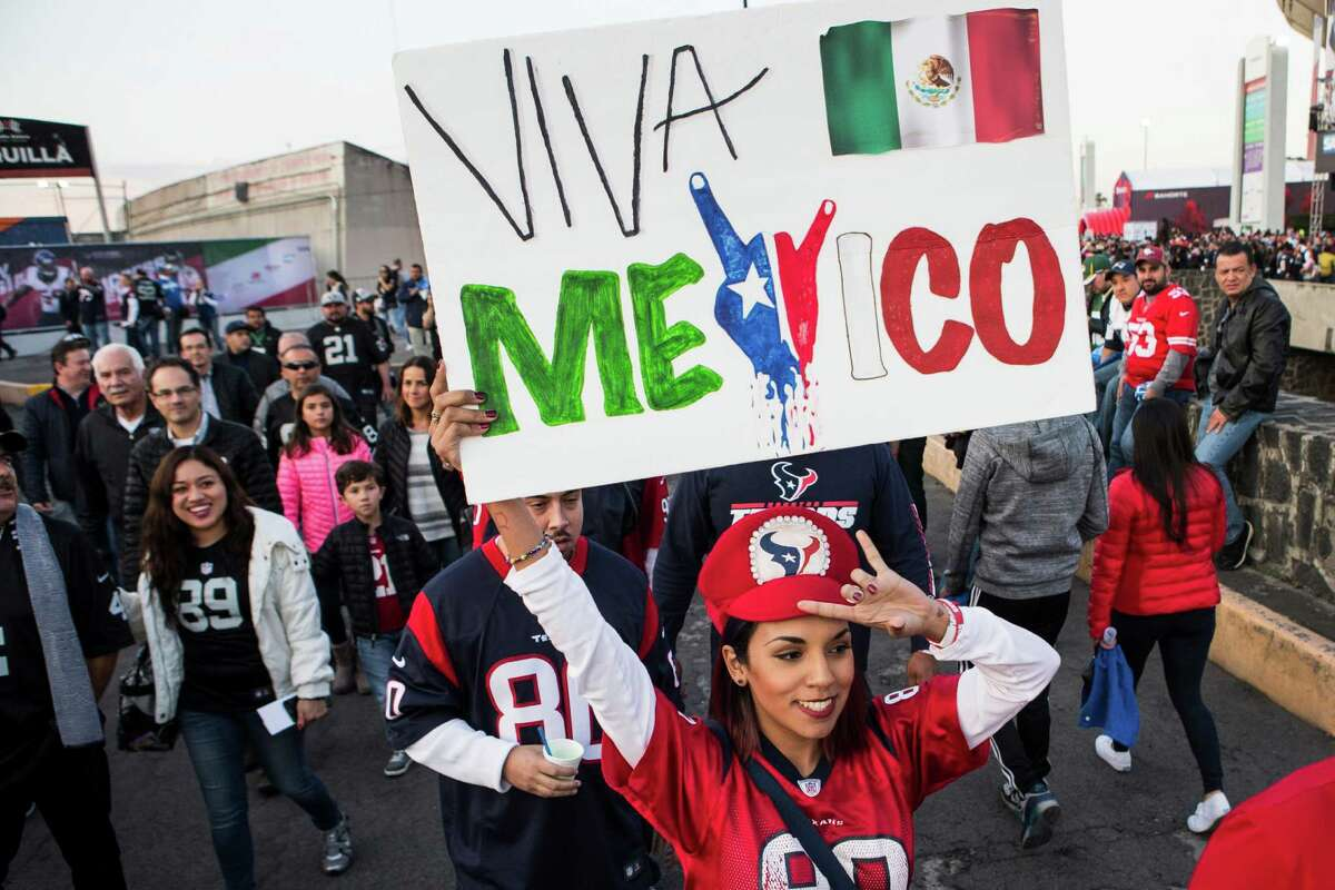 Houston Texans fans walk into the stadium before an NFL football game between the Houston Texans and the Oakland Raiders at Estadio Azteca on Monday, Nov. 21, 2016, in Mexico City.