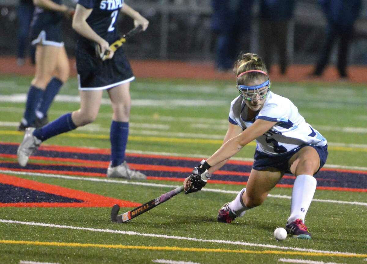 Wilton's Emma Rosen scored the winning goal as the Warriors defeated Staples to win the FCIAC field hockey championship.