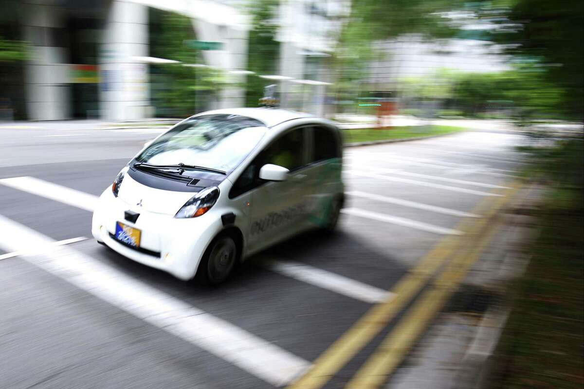 An autonomous vehicle is driven during its test drive in Singapore on Aug. 24. Texas officials are preparing for autonomous vehivcle testing at both research campsues and in urban environments, such as Houston.
