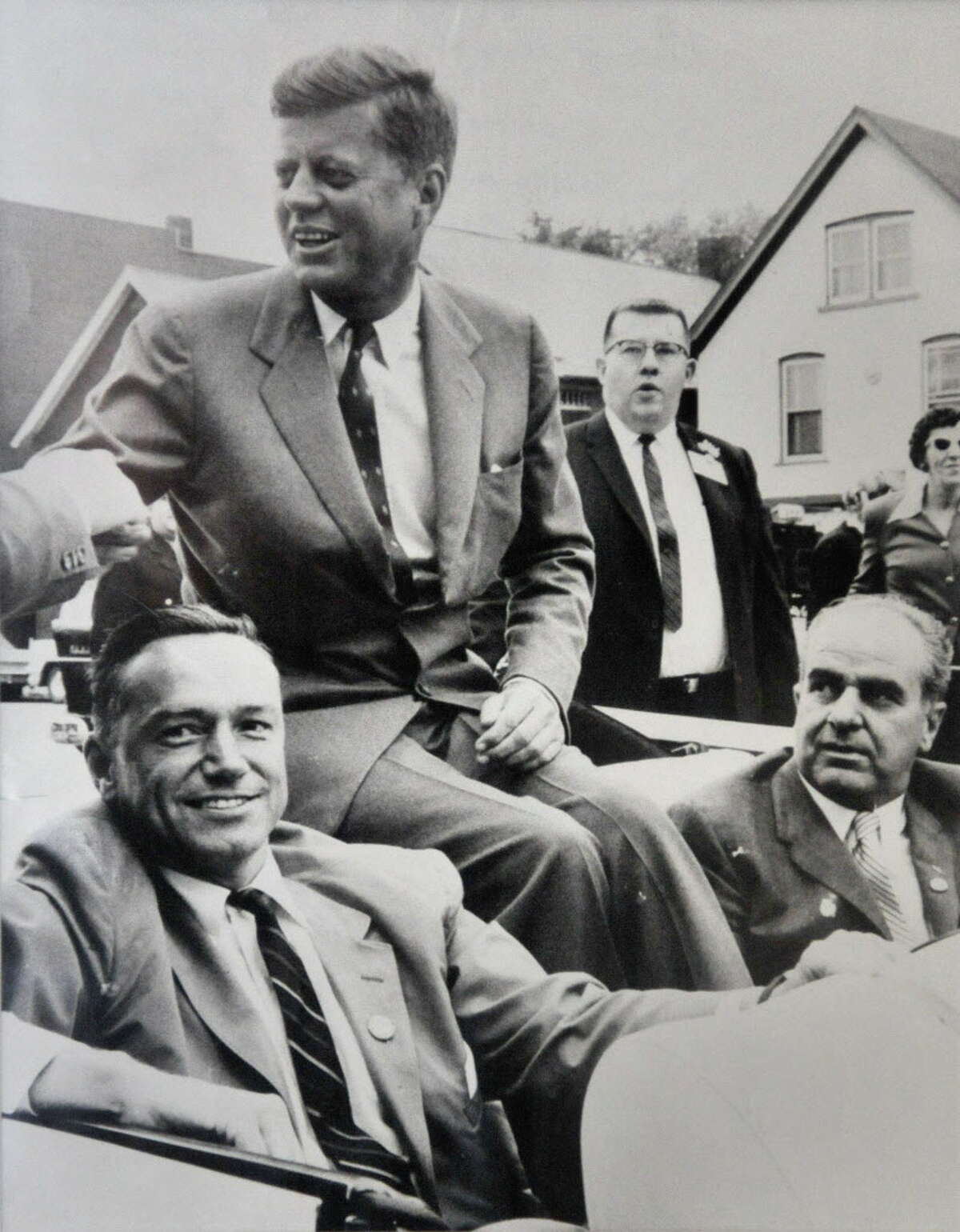 Photograph courtesy of Mayor Brian Stratton: Undated B&W photo of then US Congressman Sam Stratton (lower left) riding in a motorcade with John F. Kennedy during a campaign stop in Schenectady. Others in photograph are unidentified. (for Times Union story)