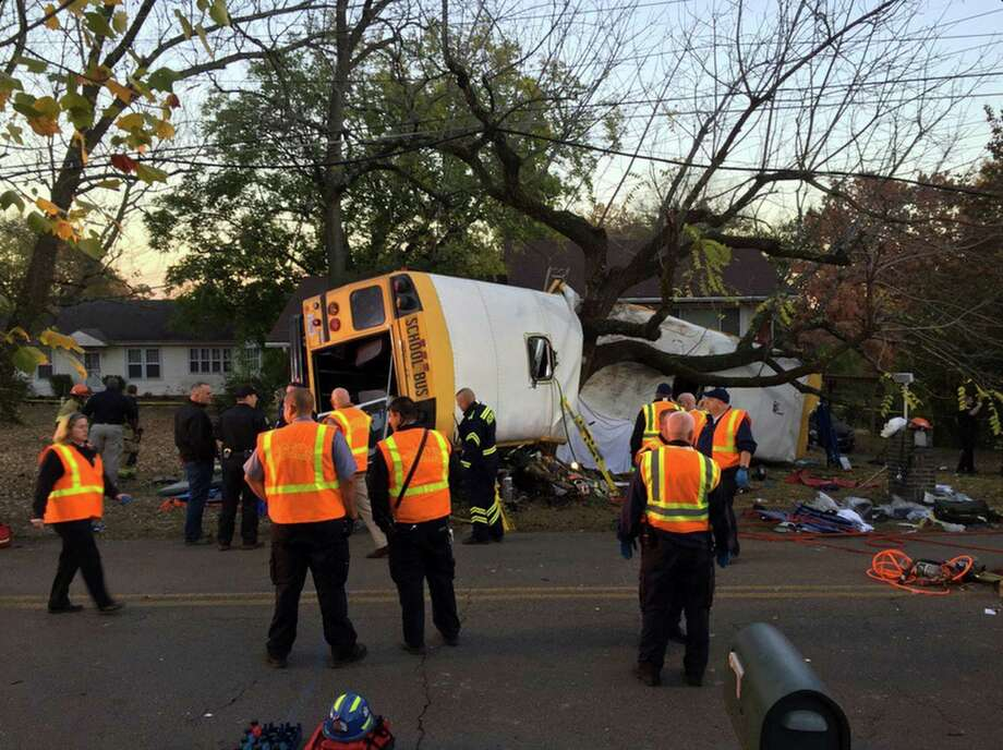 Chattanooga Fire Department personnel work the school bus crash scene Monday. The bus was carrying students ranging from kindergarten to fifth grade. Photo: Bruce Garner, HOGP / Chattanooga Fire Department