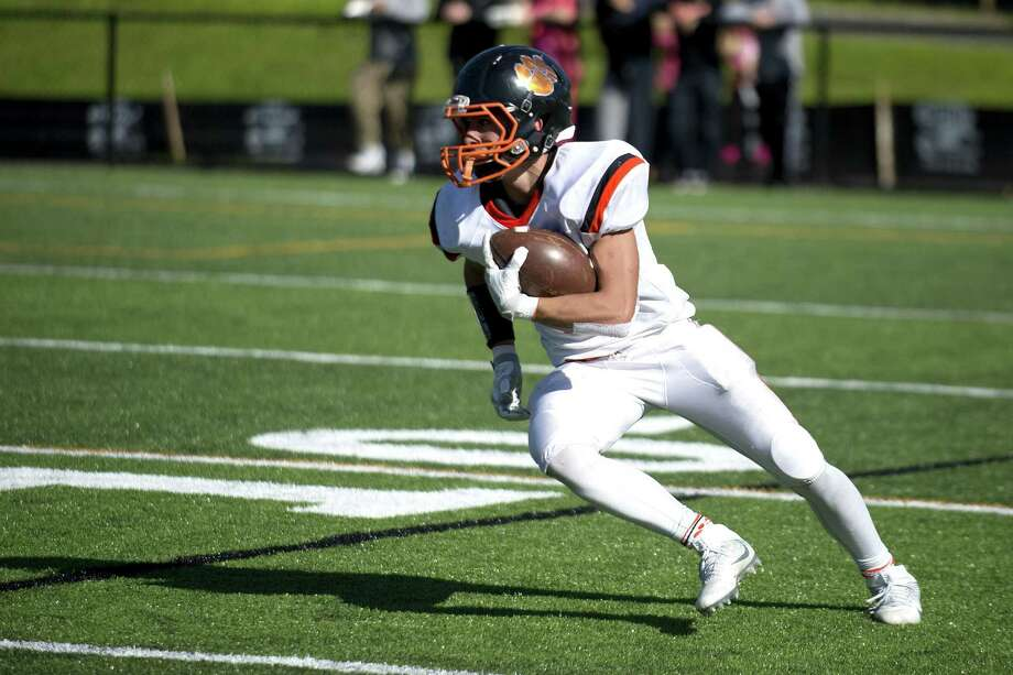 Ridgefield's Shane Palmer carries the ball during Saturday's game at Trinity Catholic on October 15, 2016. Photo: Lindsay Perry / For Hearst Connecticut Media / Stamford Advocate Freelance