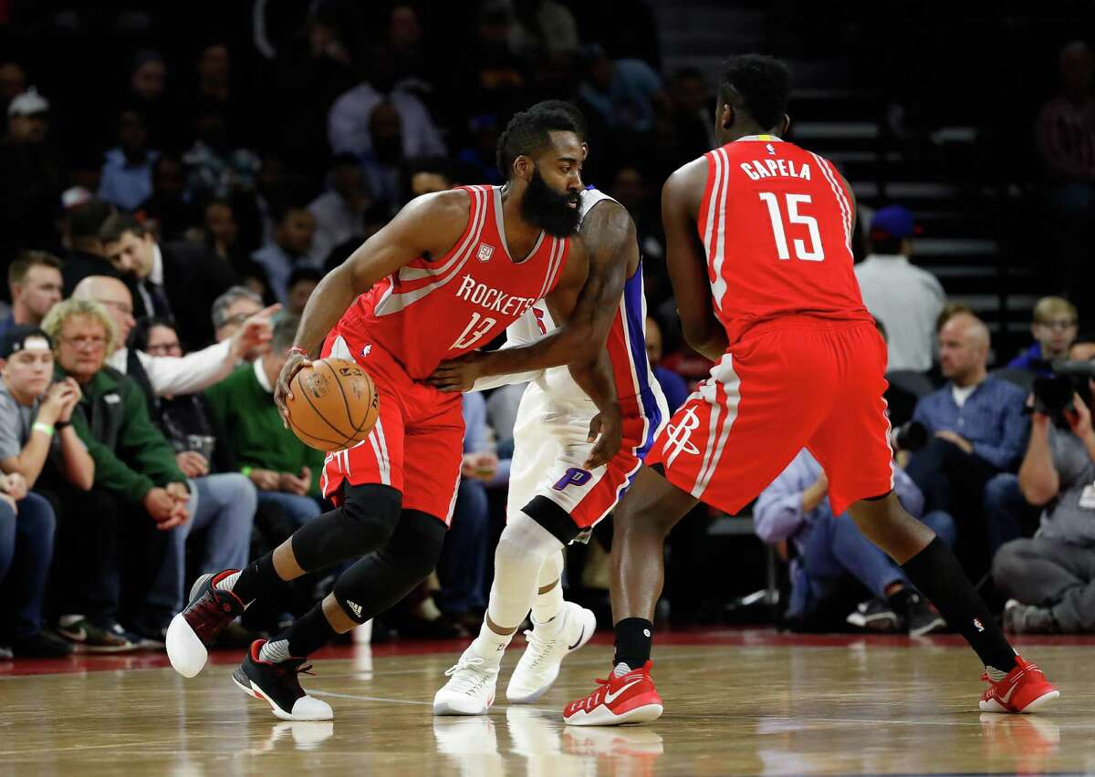 AUBURN HILLS, MI - NOVEMBER 21: James Harden #13 of the Houston Rockets tries to avoid the defense of Kentavious Caldwell-Pope #5 of the Detroit Pistons during the first half at the Palace of Auburn Hills on November 21, 2016 in Auburn Hills, Michigan. NOTE TO USER: User expressly acknowledges and agrees that, by downloading and or using this photograph, User is consenting to the terms and conditions of the Getty Images License Agreement.
