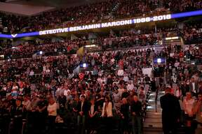 A moment of silence is held for San Antonio Police Department Det. Benjamin Marconi, was fatally shot while performing a routine traffic stop Sunday Nov. 20, 2016,  before the San Antonio Spurs and Dallas Mavericks game Monday Nov. 21, 2016 at the AT&T Center.