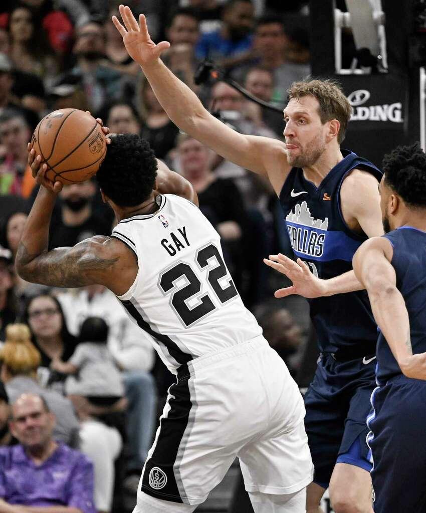 Dallas Mavericks guard Seth Curry (30) drives around San Antonio Spurs center Pau Gasol, of Spain, during the first half of an NBA basketball game, Monday, Nov. 21, 2016, in San Antonio. (AP Photo/Darren Abate)