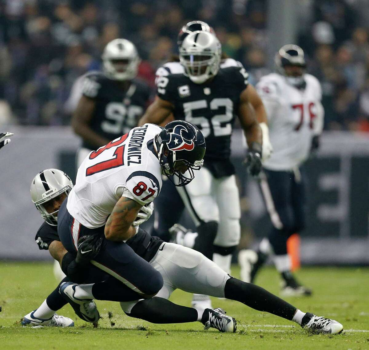 Houston Texans tight end C.J. Fiedorowicz (87) is brought down after a catching a pass during the first quarter of an NFL football game at Estadio Azteca on Monday, Nov. 21, 2016, in Mexico City.