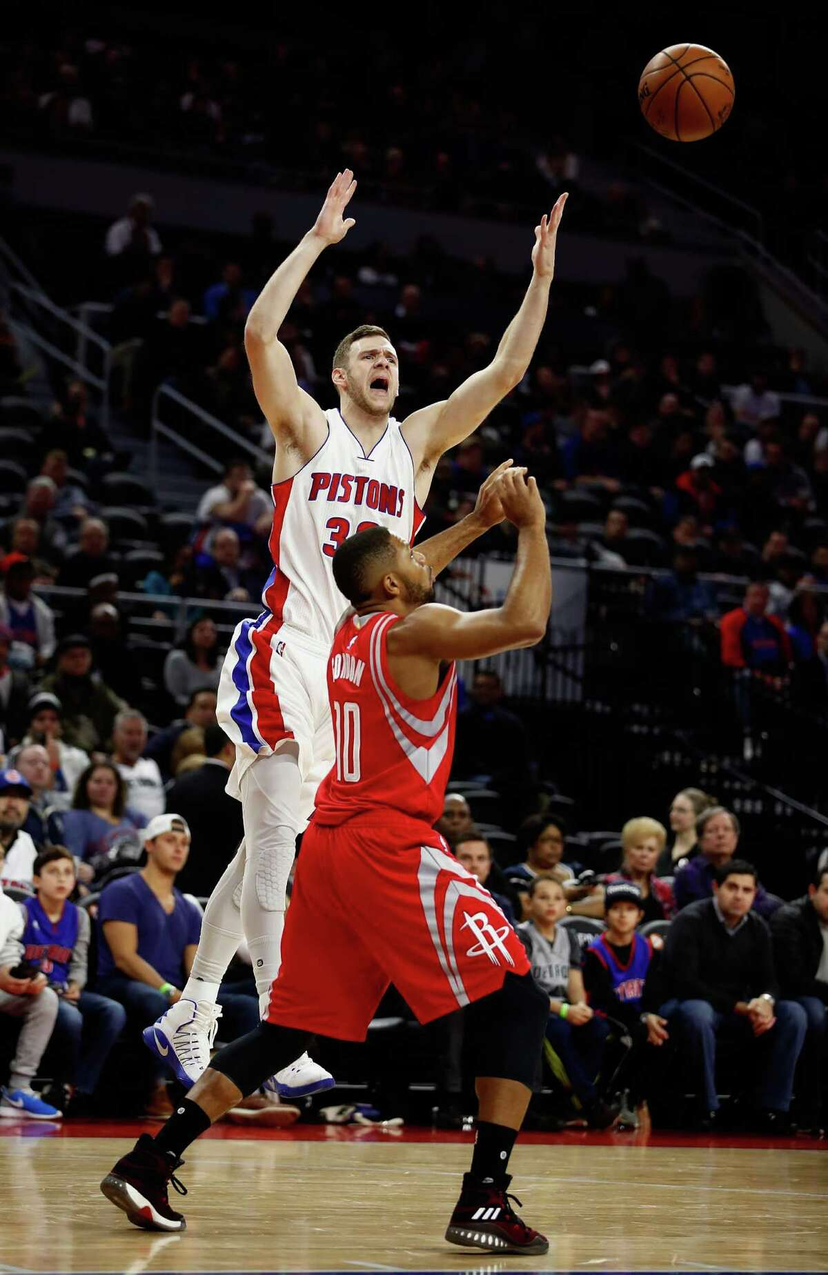 AUBURN HILLS, MI - NOVEMBER 21: Jon Leuer #30 of the Detroit Pistons battles for a rebound with Eric Gordon #10 of the Houston Rockets during the first half at the Palace of Auburn Hills on November 21, 2016 in Auburn Hills, Michigan. NOTE TO USER: User expressly acknowledges and agrees that, by downloading and or using this photograph, User is consenting to the terms and conditions of the Getty Images License Agreement.