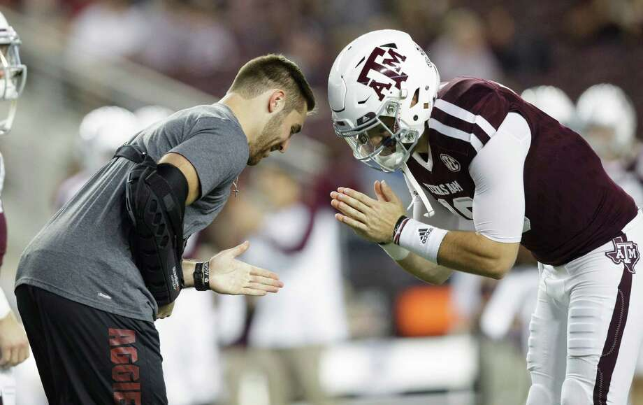The pregame ritual of A&M quarterbacks Trevor Knight, left, and Jake Hubenak will take a backseat Thursday to the possibility that both will be testing shoulder injuries before the game against LSU. Photo: Sam Craft, FRE / AP