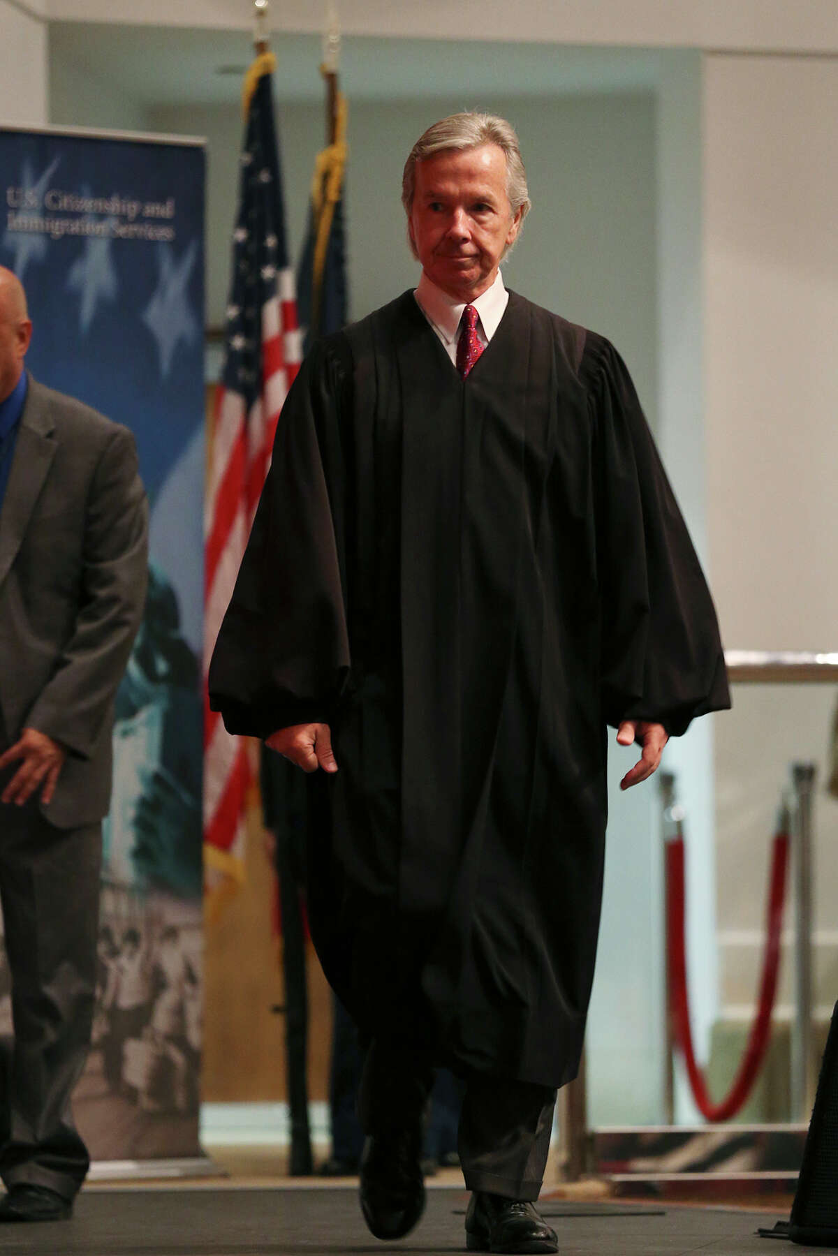 U.S. Magistrate Judge John W. Primomo arrives for one of two naturalization ceremonies at the Edgewood Theatre of Performing Arts for a naturalization ceremony, Thursday, August 20, 2015. The U.S. Citizens and Immigration Services held two ceremonies during the day for a total of 994 new citizens.