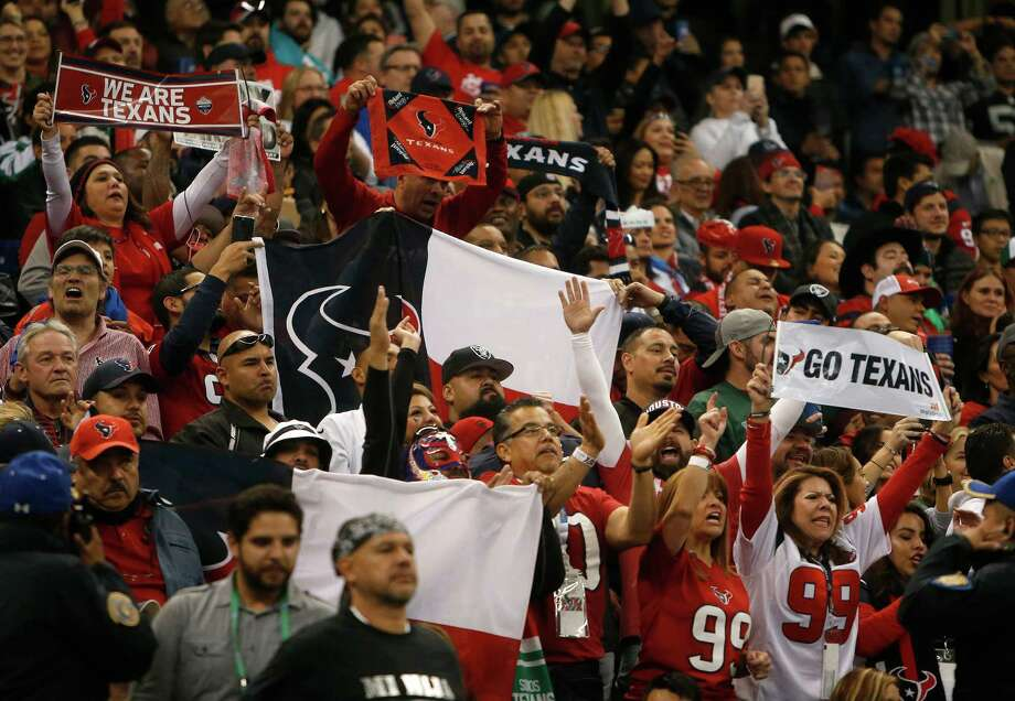 Houston Texans fans celebrate after wide receiver Braxton Miller's touchdown during the second quarter of an NFL football game at Estadio Azteca on Monday, Nov. 21, 2016, in Mexico City. Photo: Brett Coomer, Houston Chronicle / © 2016 Houston Chronicle