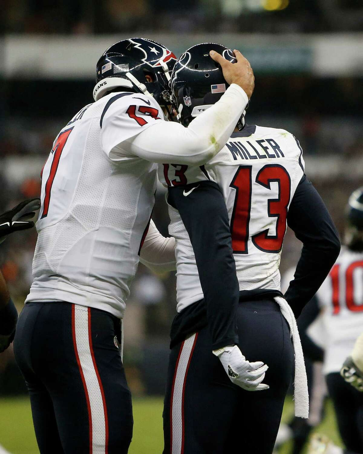 Houston Texans wide receiver Braxton Miller (13) celebrates his touchdown with quarterback Brock Osweiler (17) during the second quarter of an NFL football game at Estadio Azteca on Monday, Nov. 21, 2016, in Mexico City.