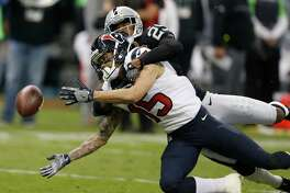 Houston Texans wide receiver Will Fuller (15) reaches for the ball as he is brought down by Oakland Raiders cornerback David Amerson (29) during the second quarter of an NFL football game at Estadio Azteca on Monday, Nov. 21, 2016, in Mexico City.