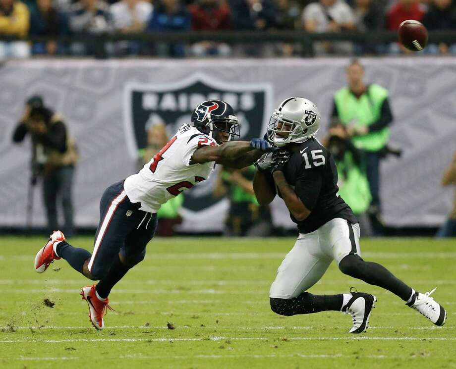 Houston Texans cornerback Johnathan Joseph (24) breaks up a pass intended for Oakland Raiders wide receiver Michael Crabtree (15) on a Raiders fourth down during the second quarter of an NFL football game at Estadio Azteca on Monday, Nov. 21, 2016, in Mexico City. Photo: Brett Coomer, Houston Chronicle / © 2016 Houston Chronicle